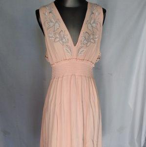 Lush peach color summer dress.